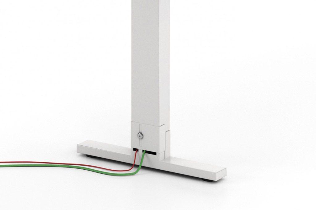 Solución estándar TWork, de pata intermedia electrificable para la creación de mesas multipuesto.
